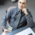 man sitting at office desk stock photo © elenaphoto