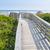Wooden walkway to ocean beach stock photo © elenaphoto