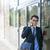 biznesmen · mówić · telefonu · komórkowego · lobby · telefonu · człowiek - zdjęcia stock © elenaphoto