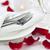 romantic dinner setting with rose petals stock photo © elenaphoto
