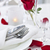 romantic dinner setting with rose petals stock photo © elenaphoto