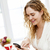 smiling woman using smart phone stock photo © elenaphoto
