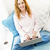 улыбающаяся · женщина · диване · красивой · улыбаясь - Сток-фото © elenaphoto