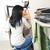 femme · regarder · à · l'intérieur · frigo · vue · arrière · confondre - photo stock © elenaphoto