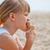 jovem · alimentação · sorvete · praia · jovem · bonitinho - foto stock © ElinaManninen