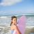 fiatal · lány · áll · szörfdeszka · tengerpart · aranyos · óceán - stock fotó © elinamanninen