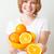 женщину · апельсинов · чаши · свежие - Сток-фото © ElinaManninen