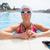 feminino · piscina · óculos · de · proteção · borda - foto stock © ElinaManninen