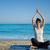 meditál · jóga · tenger · női · ül · óceán - stock fotó © ellensmile