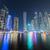 felhőkarcolók · Dubai · éjszaka · épület · város · építkezés - stock fotó © elnur