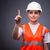 cute construction worker pressing virtual buttons stock photo © elnur