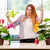 redhead woman taking care of plants at home stock photo © elnur