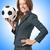 businesswoman with football on white stock photo © elnur