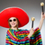 girl in mexican vivid poncho with maracas against gray stock photo © elnur