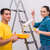young couple painting wall at home stock photo © elnur