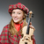 Woman in scottish clothing in musical concept stock photo © Elnur