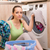 woman doing laundry at home stock photo © elnur