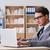 empresário · trabalhando · escritório · em · casa · casual · casa · sessão - foto stock © elnur