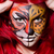 woman with tiger face in halloween concept stock photo © elnur
