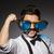 elegante · hombre · azul · camisa · gafas · de · sol - foto stock © elnur