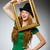 woman wearing green dress holding picture frame stock photo © elnur