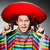 man in vivid mexican poncho holding handgun against gray stock photo © elnur