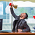 businessman winning cup trophy in the office stock photo © elnur