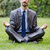 young businessman meditating in the garden stock photo © elnur