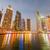felhőkarcolók · Dubai · éjszaka · üzlet · égbolt · épület - stock fotó © elnur