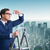 the businessman climbing ladder in business concept stock photo © elnur