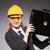 construction worker in helmet against gray stock photo © elnur