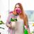 mujer · plantas · casa · retrato · sonriendo - foto stock © elnur