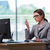 businesswoman staying in the office for long hours stock photo © elnur