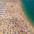 переполненный · пляж · небе · солнце · синий · песок - Сток-фото © elxeneize