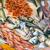 fresh fish and seafood at a market stock photo © elxeneize