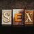 sex letterpress concept on dark background stock photo © enterlinedesign