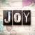 joy concept metal letterpress type stock photo © enterlinedesign