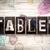 tablet concept metal letterpress type stock photo © enterlinedesign