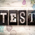 test concept metal letterpress type stock photo © enterlinedesign