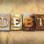 debt concept rusted metal type stock photo © enterlinedesign