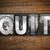 quit concept metal letterpress type stock photo © enterlinedesign