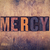 mercy concept wooden letterpress type stock photo © enterlinedesign