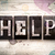 help concept metal letterpress type stock photo © enterlinedesign