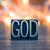 god concept metal letterpress type stock photo © enterlinedesign