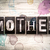 mother concept metal letterpress type stock photo © enterlinedesign