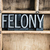 felony concept metal letterpress word in drawer stock photo © enterlinedesign