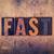 fast concept wooden letterpress type stock photo © enterlinedesign