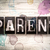parent concept metal letterpress type stock photo © enterlinedesign
