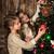 beautiful girls decorating christmas tree stock photo © es75
