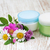 containers with cream and wild flowers stock photo © es75